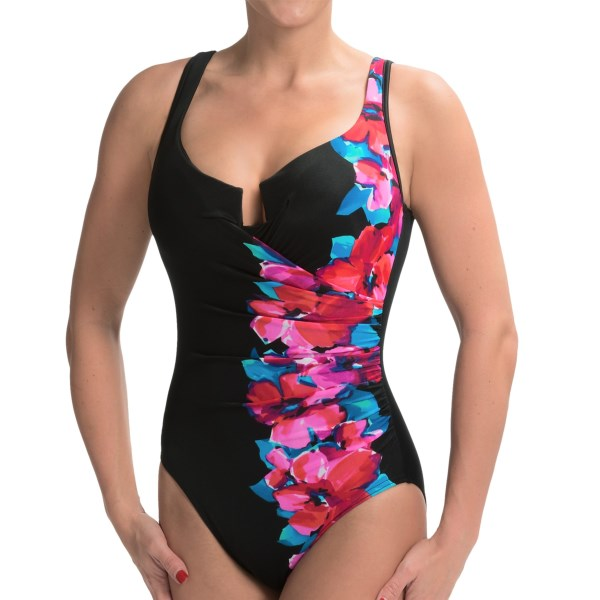 CLOSEOUTS . Flashy florals, slimming side ruching and supportive, shaping cups -- Miraclesuitand#39;s Escape one-piece swimsuit truly has it all,  plus  a hidden control panel that visually smooths and shapes trouble zones. Available Colors: BLACK. Sizes: 8, 10, 12, 14, 16.