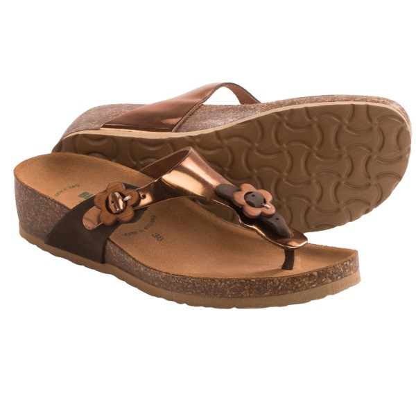 CLOSEOUTS . Two funky floral buckles lend flower-power style to BioNaturaand#39;s Spices sandals, a chic pair of low-wedge slip-ons with an anatomic, foot-forming cork footbed and oodles of fresh style. Available Colors: WHITE/SILVER, BLACK, DARK BROWN/BRONZE. Sizes: 36, 37, 38, 39, 40, 41.