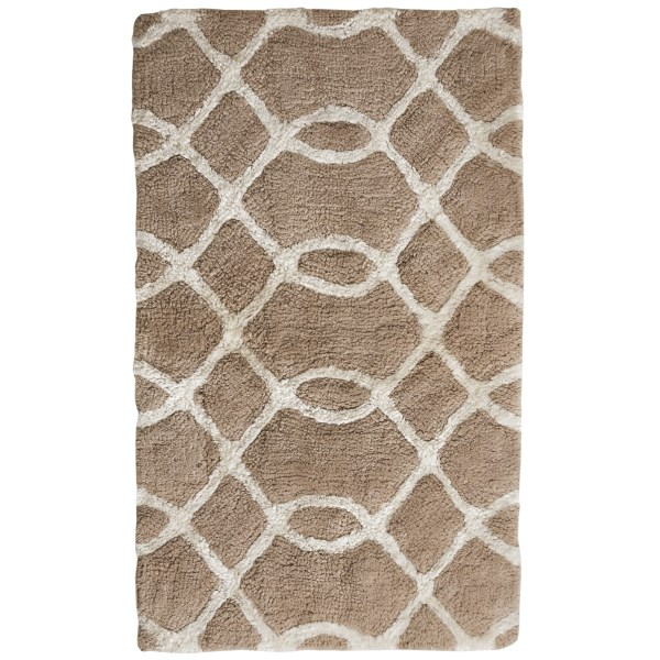 CLOSEOUTS . Step from the shower and into the incomparable softness of Vista Homeand#39;s Mosa Trellis bath rug -- patterned in the soft, abstract geometrics of a garden trellis in supersoft, absorbent cotton. Available Colors: SAND / IVORY, PINK / IVORY, MORNING MIST / IVORY, DOVE GREY / IVORY.