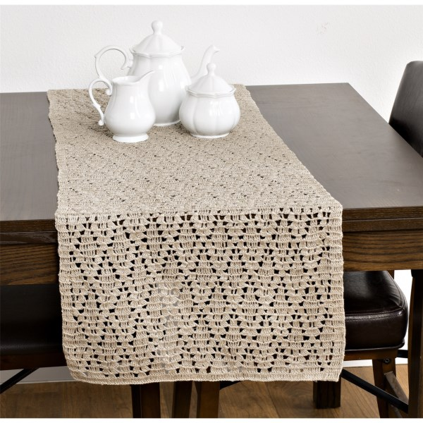 CLOSEOUTS . Hand-crocheted in pure, natural linen, this Coyuchi table runner features an open diamond weave that lets the beautiful grain of your tabletop show through. The hand-crocheting process means there will be ever-so-slight variations in size, and no two will be exactly alike. Available Colors: NATURAL.