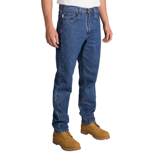 2NDS . Job site favorites, Carharttand#39;s relaxed fit jeans offer comfortable durability with a tapered-leg design thatand#39;s ideal for tucking into boots for safety. The relaxed seat and thigh offer day-long flexibility and non-restrictive wear. Available Colors: DARKSTONE.