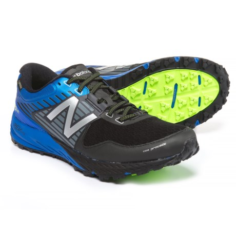 New Balance 910V4 Trail Running Shoes (For Men) in Black/Vivid Cobalt Blue
