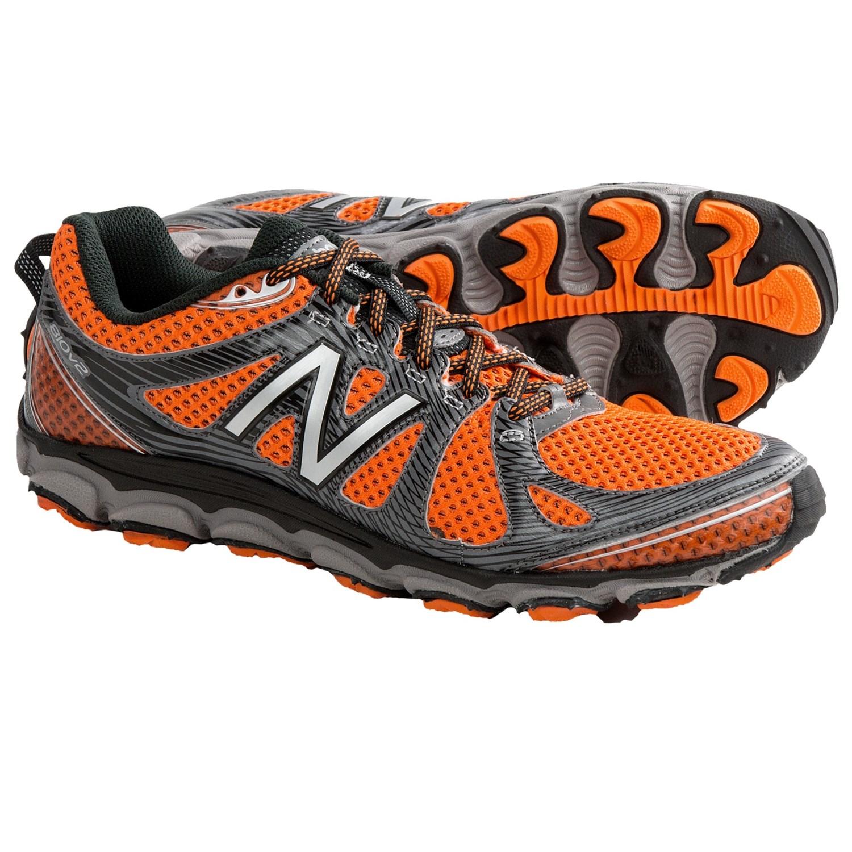 New Balance MT810 Trail Running Shoes (For Men) in Black/Orange