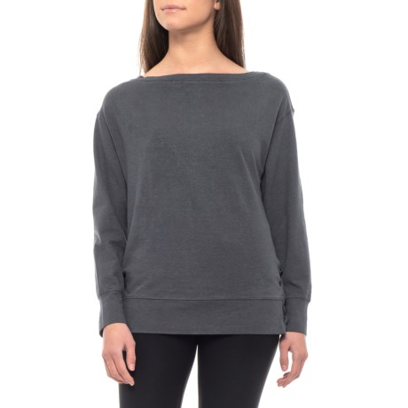 CLOSEOUTS. Search no more for that perfect weekend top, weand#39;ve got it in prAnaand#39;s Ostara shirt. Itand#39;s made from a soft hemp-and-organic-cotton-blend jersey in a relaxed fit with just enough stretch for comfort; it also features a flattering boat neck and side lacing accents at the hem. Available Colors: COAL, NAUTICAL ROSEWOOD, WINE ROSEWOOD. Sizes: XS, S, M, L, XL, 2XL.