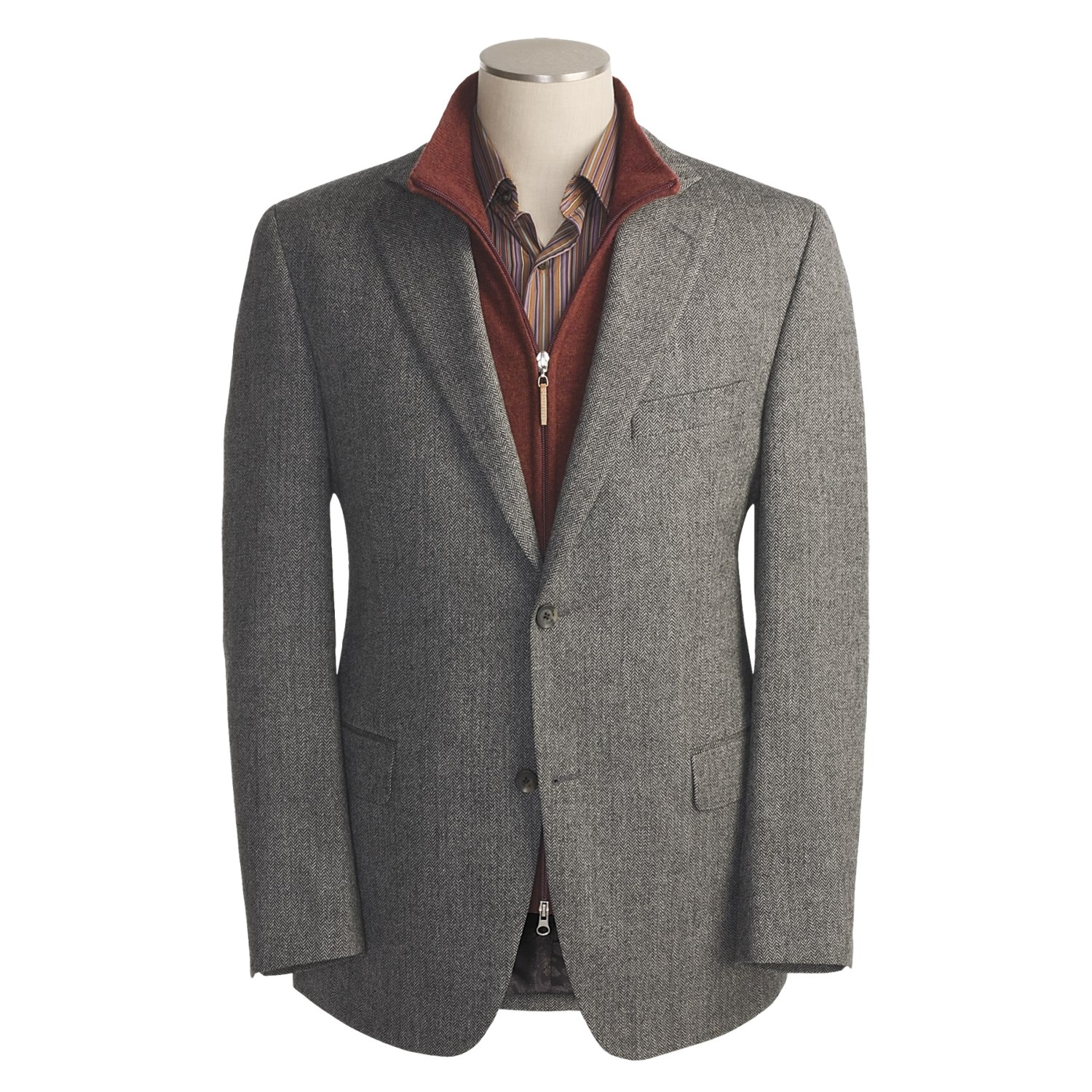 When the occasion calls for a traditional, handsome look, our herringbone sport coat fits the bill. Named for the quintessentially Scottish border town of Langholm, our jacket is constructed of fine, pure wool from Scotland, fully lined for a smooth fit over a sweater vest or dress shirt.