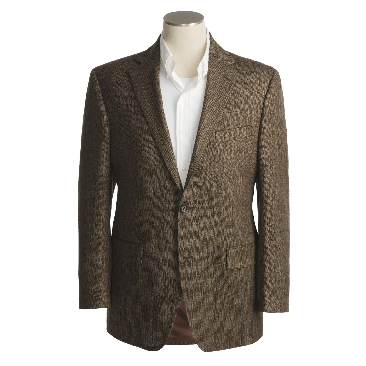 A Circle S Sport Coat is perfect for when it's time to kick your western style up a notch. Made with a polyester and rayon blend, this striking grey herringbone western sport coat features distinctive western yokes on front and back, to go with spade flap pockets near the hem.