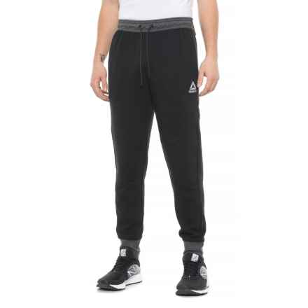 aae84826e23 Reebok No Timeouts Joggers (For Men) in Black/Charcoal Heather