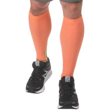 SKINS Essential Calf Tights MX - UPF 50+ (For Men and Women) in Pomelo - Closeouts